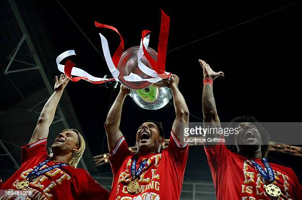 Claudio Pizarro of Bayern Muenchen holds the trophy after winning the UEFA Champions League final match against Borussia Dortmund at Wembley Stadium...