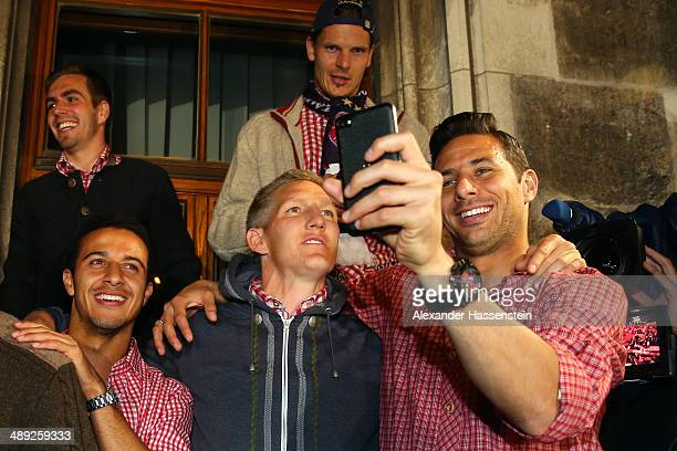 Claudio Pizarro of Bayern Muenchen takes a self portrait with his team mate Bastian Schweinsteiger during the celebration of the German championship...