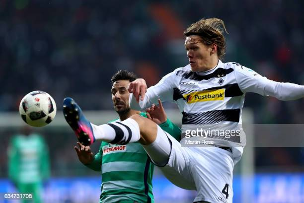 Claudio Pizarro of Bremen and Jannik Vestergaard of Moenchengladbach battle for the ball during the Bundesliga match between Werder Bremen and...