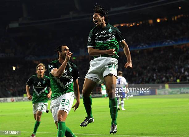Claudio Pizarro of Bremen celebrates after scoring his team's 3rd goal during the Uefa Champions League qualifying match between Werder Bremen and...
