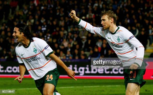 Claudio Pizarro of Bremen celebrates after scoring his team's first goal with team mate Per Mertesacker during the UEFA Europa League Group L match...