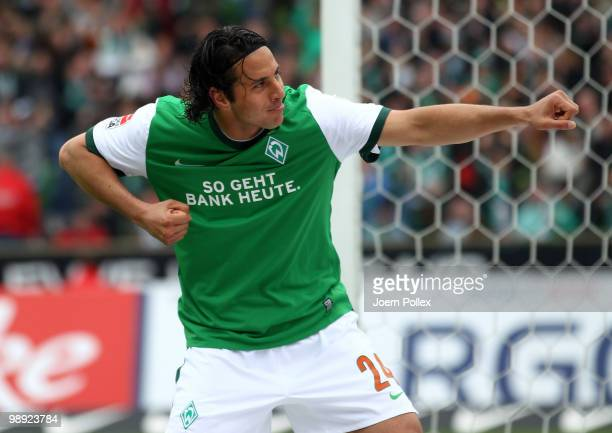 Claudio Pizarro of Bremen celebrates after scoring his team's first goal during the Bundesliga match between SV Werder Bremen and Hamburger SV at...