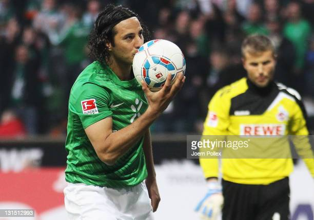 Claudio Pizarro of Bremen celebrates after scoring his team's second goal during the Bundesliga match between Werder Bremen and 1 FC Koeln at Weser...