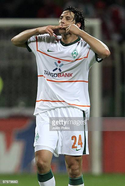Claudio Pizarro of Bremen celebrates after scoring his team's second goal during the DFB Cup Semi Final match between SV Werder Bremen and FC...