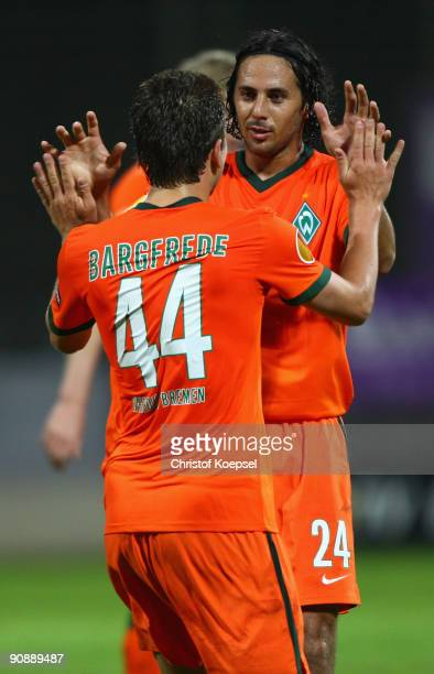 FUNCHAL MADEIRA PORTUGAL SEPTEMBER 17 Claudio Pizarro of Bremen celebrates his second goal with Philipp Bargfrede during the UEFA Europa League match...
