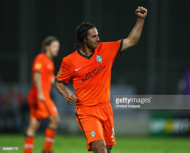 FUNCHAL MADEIRA PORTUGAL SEPTEMBER 17 Claudio Pizarro of Bremen celebrates scoring his second goal during the UEFA Europa League match between...