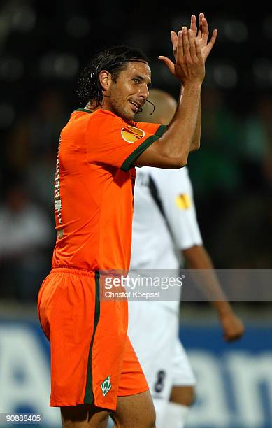 Claudio Pizarro of Bremen celebrates scoring his team's second goal during the UEFA Europa League match between Nacional Funchal and SV Werder Bremen...