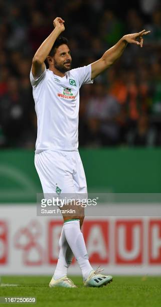 Claudio Pizarro of Bremen celebrates scoring the fifth goal during the DFB Cup first round match between Atlas Delmenhorst and SV Werder Bremen at...