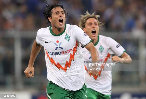 Claudio Pizarro of Bremen celebrates with his team mate Clemens Fritz after scoring his team's second goal during the Uefa Champions League...