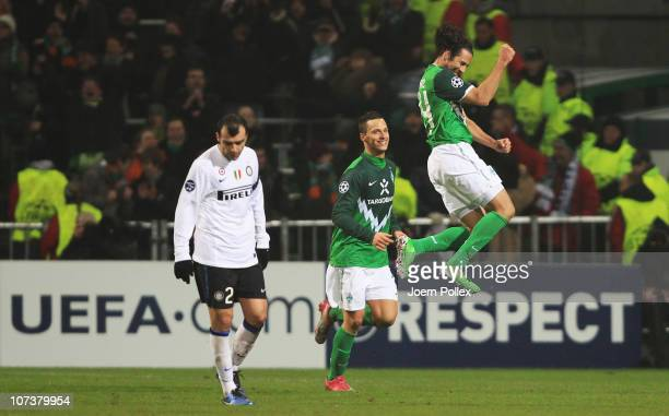 Claudio Pizarro of Bremen celebrates with his team mate Marko Arnautovic after scoring his team's third goal during the UEFA Champions League group A...