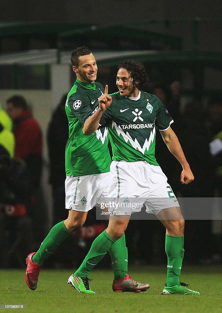 Claudio Pizarro (R) of Bremen celebrates with his team mate Marko Arnautovic after scoring his team's third goal during the UEFA Champions League group A match between SV Werder Bremen and FC Internazionale Milano at Weser Stadium on December 7, 2010 in Bremen, Germany.