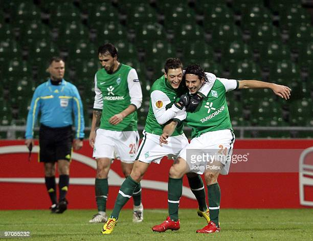 Claudio Pizarro of Bremen celebrates with his team mate Mesut Oezil after scoring his team's second goal during the UEFA Europa League knockout round...