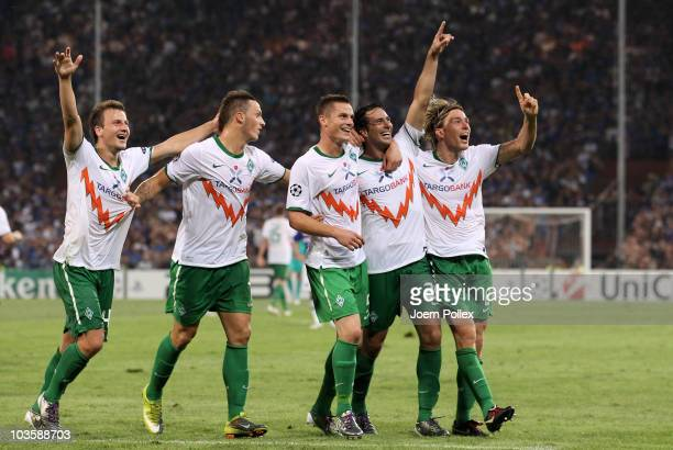 Claudio Pizarro of Bremen celebrates with his team mates after scoring his team's second goal during the Uefa Champions League qualifying second leg...