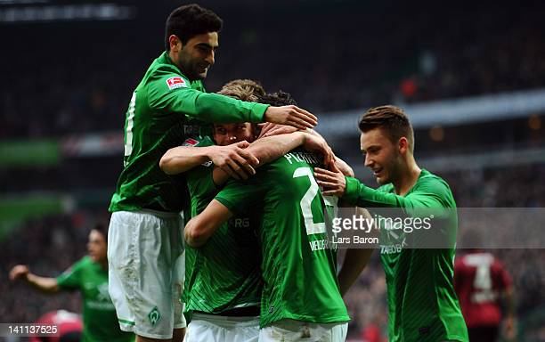 Claudio Pizarro of Bremen celebrates with team mates after scoring his teams first goal during the Bundesliga match between SV Werder Bremen and...