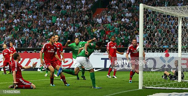 Claudio Pizarro of Bremen heads his team's opening goal during the Bundesliga match between Werder Bremen and Hamburger SV at Weser Stadium on...