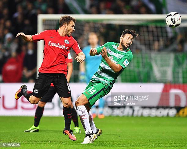 Claudio Pizarro of Bremen is challenged by Szabolcs Huszti of Frankfurt during the Bundesliga match between Werder Bremen and Eintracht Frankfurt at...