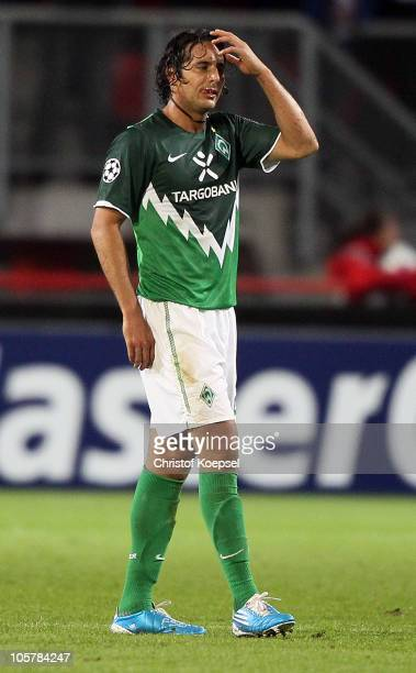 Claudio Pizarro of Bremen looks dejected after the first goal of Enschede during the UEFA Champions League group A match between FC Twente and SV...