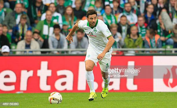 Claudio Pizarro of Bremen plays the ball during the Bundesliga match between Werder Bremen and FC Ingolstadt at Weserstadion on September 19 2015 in...