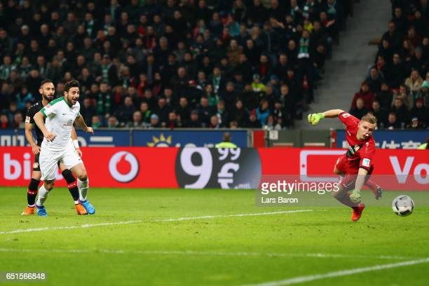 Claudio Pizarro of Bremen scores his team's first goal against goalkeeper Bernd Leno of Leverkusen during the Bundesliga match between Bayer 04...