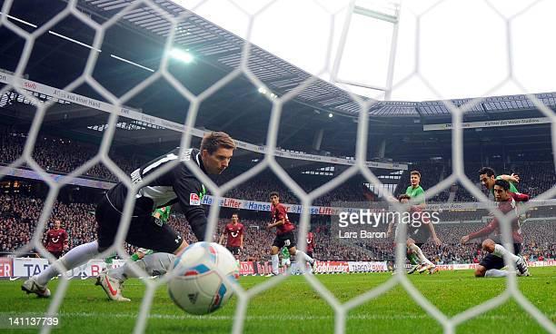 Claudio Pizarro of Bremen scores his teams first goal against goalkeeper Ron Robert Zieler of Hannover during the Bundesliga match between SV Werder...