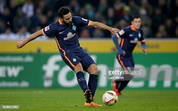 Claudio Pizarro of Bremen scores his teams first goal during the Bundesliga match between Borussia Moenchengladbach and Werder Bremen at BorussiaPark...
