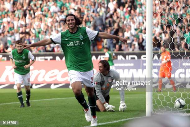 Claudio Pizarro of Bremen scores his team's third goal during the Bundesliga match between SV Werder Bremen and FSV Mainz 05 at Weser Stadium on...