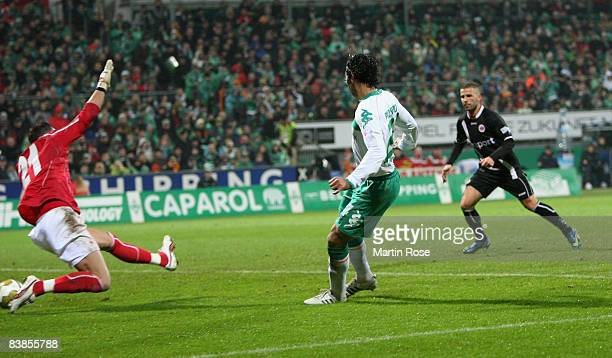 Claudio Pizarro of Bremen scores the fourth goal during the Bundesliga match between Werder Bremen and Eintracht Frankfurt at the Weser stadium on...