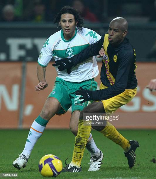 Claudio Pizarro of Bremen tackles Felipe Santana of Dortmund during the round of 16 DFB Cup match between Borussia Dortmund and SV Werder Bremen on...