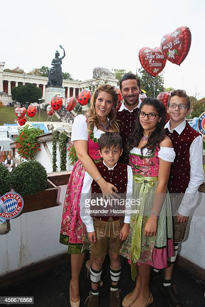 Claudio Pizarro of FC Bayern Muenchen and his wife Karla Salcedo attend the Oktoberfest beer festival at Kaefer Wiesnschaenke tent at Theresienwiese...