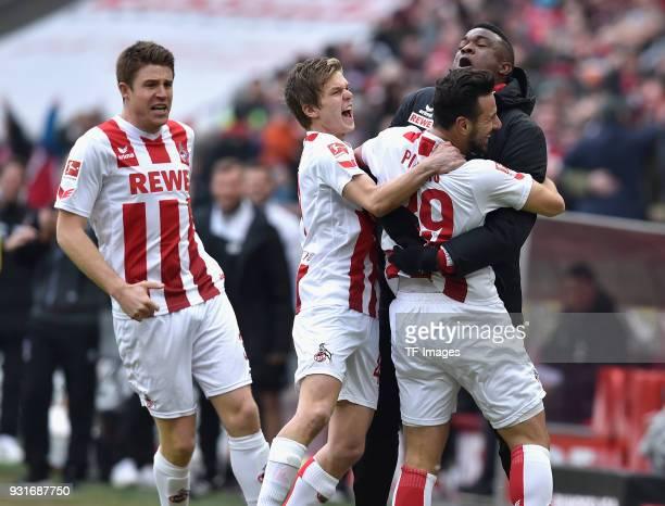 Claudio Pizarro of Koeln celebrates after scoring his team`s first goal with Dominique Heintz of Koeln Vincent Koziello of Koeln and Jhon Cordoba of...