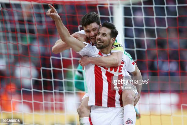 Claudio Pizarro of Koeln celebrates his goal before referee Markus Schmidt takes it back because of offside during the Bundesliga match between 1 FC...