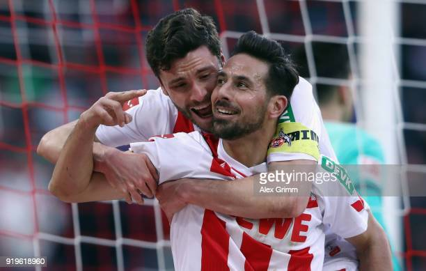Claudio Pizarro of Koeln celebrates his goal with team mate Jonas Hector before referee Markus Schmidt takes it back because of offside during the...