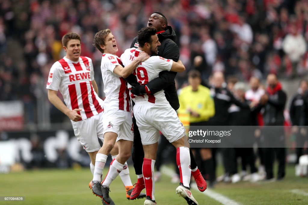 Claudio Pizarro of Koeln celebrates the first goal with John Cordoba of Koeln (R) to the Bundesliga match between 1. FC Koeln and VfB Stuttgart at RheinEnergieStadion on March 4, 2018 in Cologne, Germany.