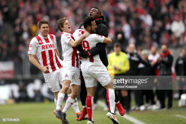 Claudio Pizarro of Koeln celebrates the first goal with John Cordoba of Koeln to the Bundesliga match between 1 FC Koeln and VfB Stuttgart at...