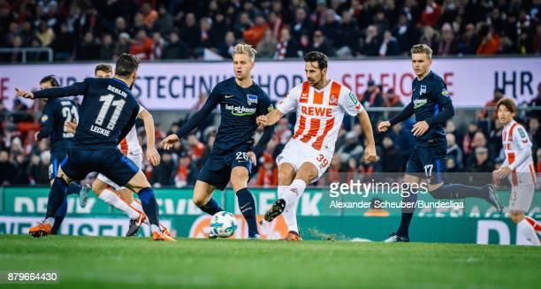 Claudio Pizarro of Koeln in action against Arne Maier of Berlin during the Bundesliga match between 1 FC Koeln and Hertha BSC at RheinEnergieStadion...
