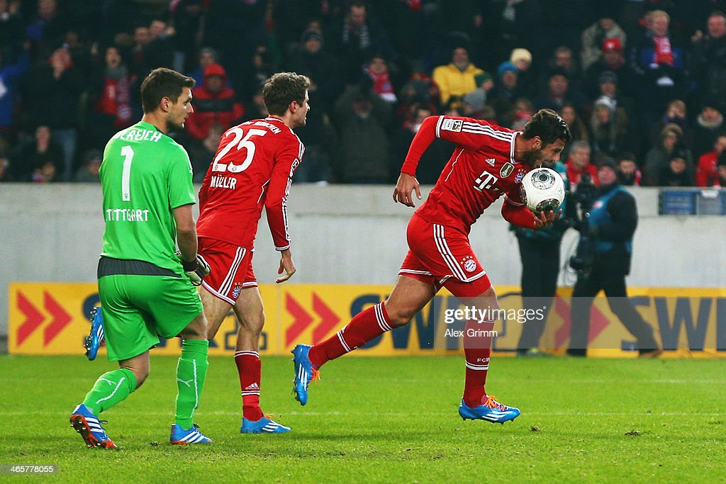 Claudio Pizarro of Muenchen celebrates his team's first goal with team mate Thomas Mueller as goalkeeper Sven Ulreich of Stuttgart reacts during the Bundesliga match between VfB Stuttgart and FC Bayern Muenchen at Mercedes-Benz Arena on January 29, 2014 in Stuttgart, Germany.