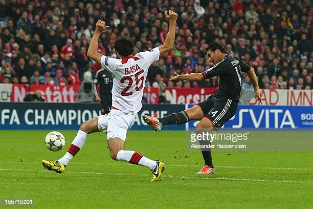 Claudio Pizarro of Muenchen scores the second team goal against Marko Basa of Lille during the UEFA Champions League group F match between FC Bayern...