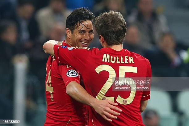 Claudio Pizarro of Munich celebrates scoring the 2nd team goal with his team mate Thomas Mueller during the UEFA Champions League quarter-final...