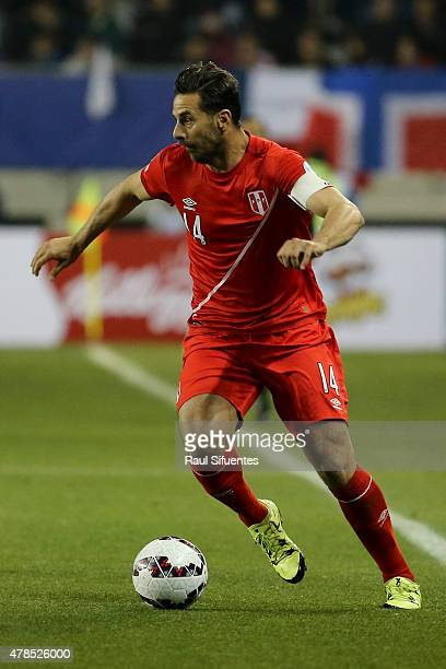 Claudio Pizarro of Peru drives the ball during the 2015 Copa America Chile quarter final match between Peru and Bolivia at German Becker Stadium on...