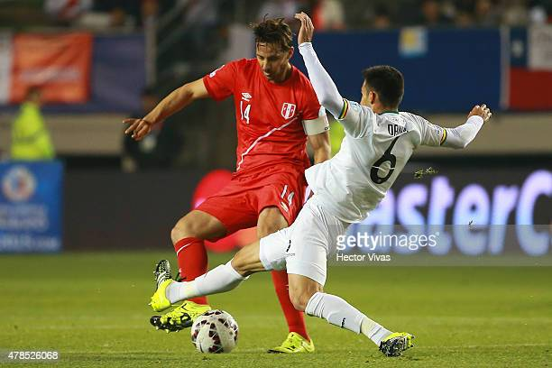 Claudio Pizarro of Peru fights for the ball with Danny Bejarano of Bolivia during the 2015 Copa America Chile quarter final match between Peru and...