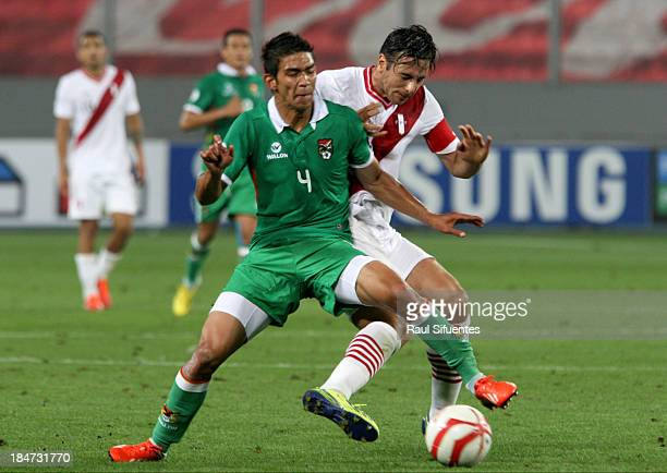 Claudio Pizarro of Peru fights for the ball with Diego Bejarano of Bolivia during a match between Peru and Bolivia as part of the 18th round of the...