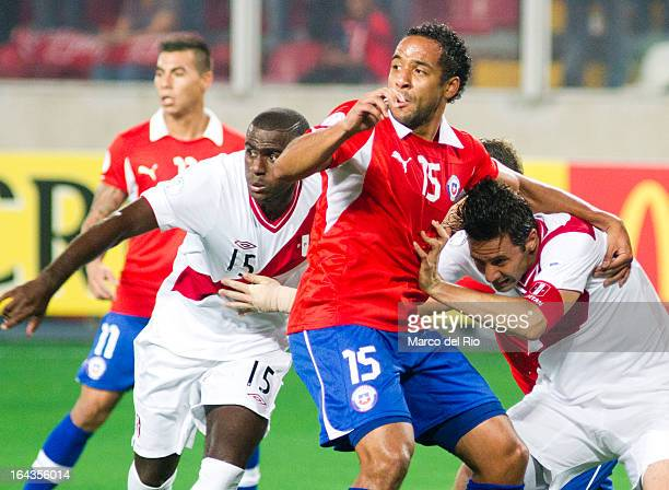 Claudio Pizarro of Peru fights for the ball with Jean Beausejour of Chile during a match between Peru and Chile as part of the 11th round of the...