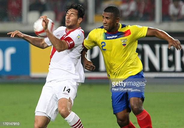 Claudio Pizarro of Peru fights for the ball with Jorge Guagua of Ecuador during a match between Peru and Ecuador as part of the 13th round of the...
