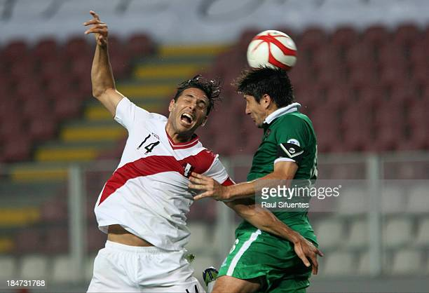 Claudio Pizarro of Peru fights for the ball with Ronald Raldes of Bolivia during a match between Peru and Bolivia as part of the 18th round of the...