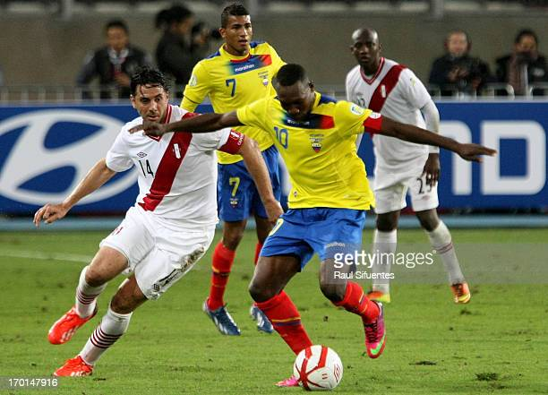 Claudio Pizarro of Peru fights for the ball with Walter Ayovi of Ecuador during a match between Peru and Ecuador as part of the 13th round of the...