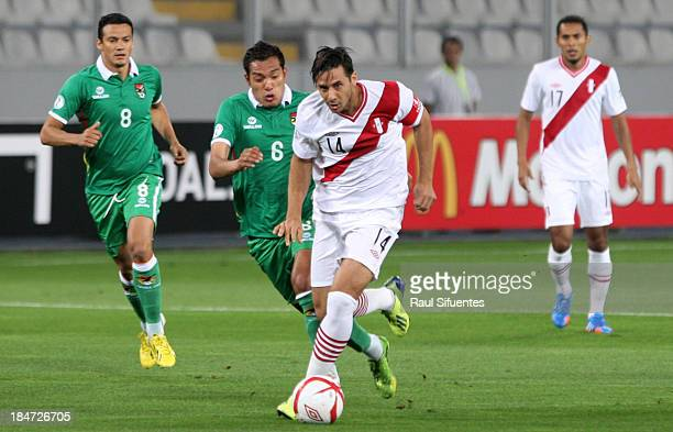 Claudio Pizarro of Peru fights for the ball with Walter Veizaga of Bolivia during a match between Peru and Bolivia as part of the 18th round of the...