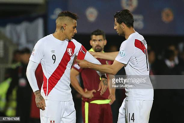 Claudio Pizarro of Peru gives the captains arm band to Paolo Guerrero of Peru during the 2015 Copa America Chile Group C match between Peru and...