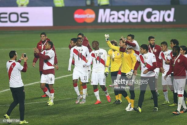 Claudio Pizarro of Peru takes a photo to his teammates after winning the 2015 Copa America Chile Third Place Playoff match between Peru and Paraguay...