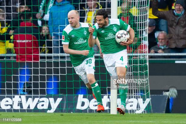 Claudio Pizarro of SV Werder Bremen celebrates after scoring his team's second goal with team mates during the Bundesliga match between SV Werder...