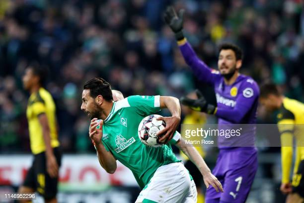 Claudio Pizarro of SV Werder Bremen celebrates after scoring his sides second goal during the Bundesliga match between SV Werder Bremen and Borussia...